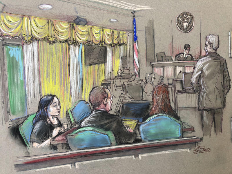 Yujing Zhang, left, who is charged with lying to illegally enter President Donald Trump's Mar-a-Lago club, listens to a hearing on Monday in West Palm Beach, Fla. (ASSOCIATED PRESS)