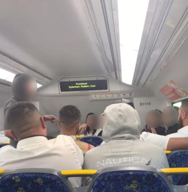A still showing a Sydney woman confronting large group of commuters who were being loud and rude on a train on a Bankstown line.