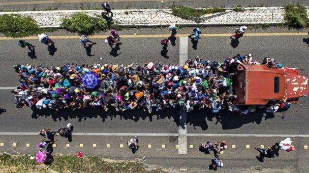 PHOTO: Aerial view of Honduran migrants on board a truck as they take part in a caravan heading to the US, in the outskirts of Tapachula, on their way to Huixtla, Chiapas state, Mexico, on Oct. 22, 2018. (Pedro Pardo/AFP/Getty Images)