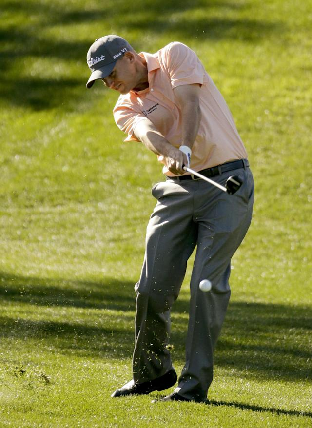 Bill Haas hits from the rough on the second hole during the third round of the Humana Challenge golf tournament on the Palmer Private course at PGA West Saturday, Jan. 18, 2014, in La Quinta, Calif. (AP Photo/Chris Carlson)