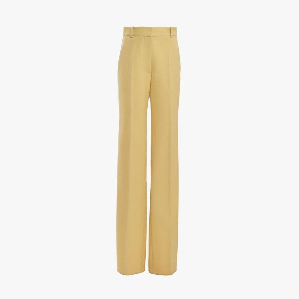 "$850, MODA OPERANDI. <a href=""https://www.modaoperandi.com/women/p/victoria-beckham/virgin-wool-split-hem-straight-leg-pants/469675?color=neutral&size=UK%2010&country=US&currency=USD&gclid=Cj0KCQjw9YWDBhDyARIsADt6sGbY-gig_ZXk9K55lzU1Df_s2K7O8dNZe0JGAeVEQQeSOu7e0H6AscQaAtdeEALw_wcB&gclsrc=aw.ds"" rel=""nofollow noopener"" target=""_blank"" data-ylk=""slk:Get it now!"" class=""link rapid-noclick-resp"">Get it now!</a>"