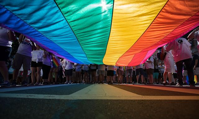 <p>Marchers unfurl a huge rainbow flag as they prepare to march in the Equality March for Unity and Pride in Washington, Sunday, June 11, 2017. (Photo: Carolyn Kaster/AP) </p>