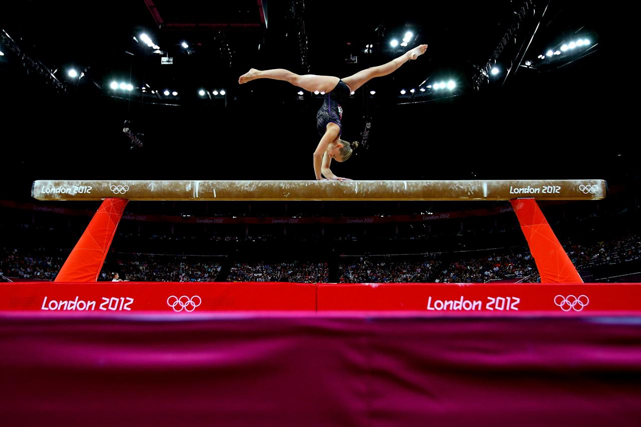 LONDON, ENGLAND - JULY 29:  Laura Svilpaite of Lithuania competes on the beam in the Artistic Gymnastics Women's Team qualification on Day 2 of the London 2012 Olympic Games at North Greenwich Arena on July 29, 2012 in London, England.  (Photo by Cameron Spencer/Getty Images)