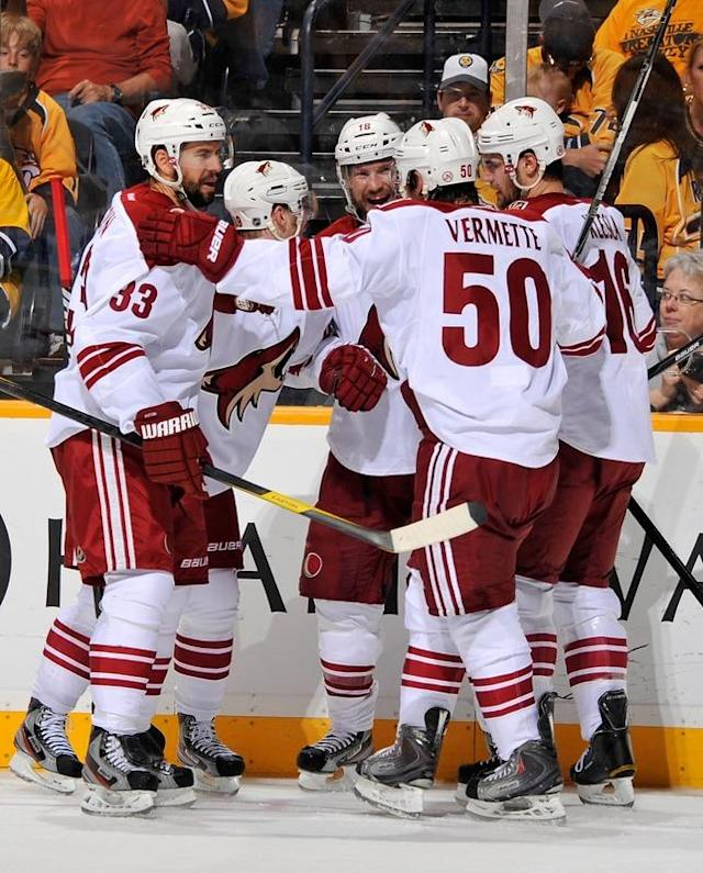NASHVILLE, TN - MAY 04: Adrian Aucoin #33 and Antoine Vermette #50 of the Phoenix Coyotes congratulated teammate Shane Doan #19 after scoring a goal against the Nashville Predators in Game Four of the Western Conference Semifinals during the 2012 NHL Stanley Cup Playoffs at the Bridgestone Arena on May 2, 2012 in Nashville, Tennessee. (Photo by Frederick Breedon/Getty Images)