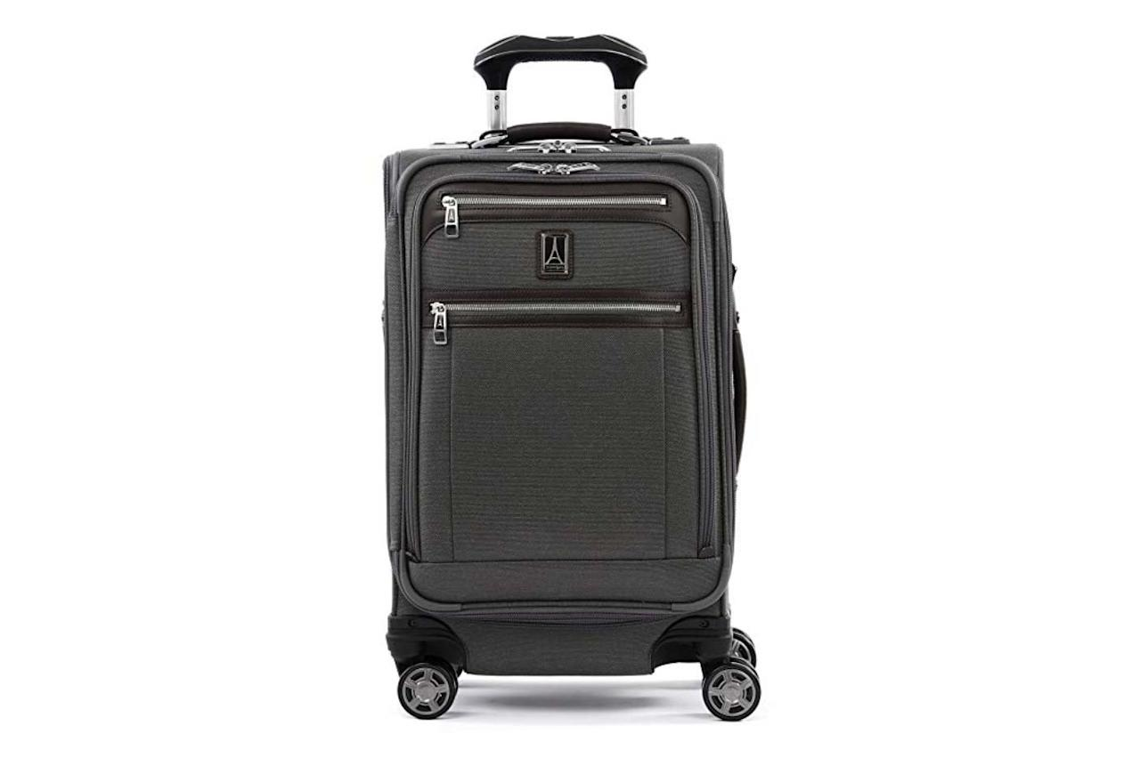 """<p>Perfect for business travelers, this carry-on suitcase has a spacious front compartment, is expandable, and features an external USB port and pocket for your powerbank.</p> <p>To buy: <a href=""""https://www.amazon.com/Travelpro-Luggage-Platinum-Expandable-Bordeaux/dp/B07DL64SYP/ref=as_li_ss_tl?ie=UTF8&camp=1789&creative=9325&linkCode=as2&creativeASIN=B07DL64SYP&tag=travandleis07-20&ascsubtag=d41d8cd98f00b204e9800998ecf8427e"""" target=""""_blank"""">amazon.com</a>, $206</p>"""