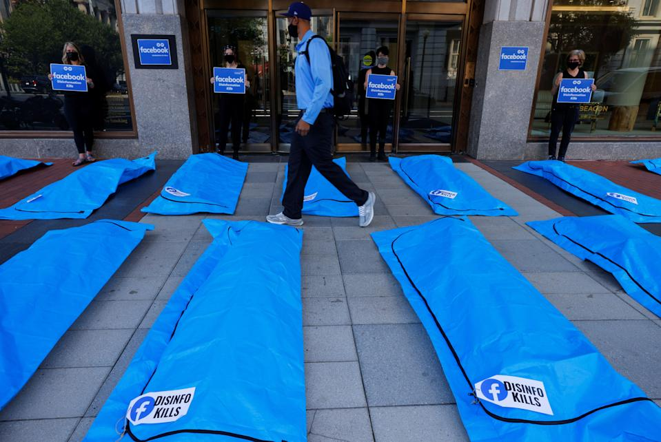Someone walks through the bodybag demonstration outside Facebook headquarters in Washington, DC (Jim Bourg/Reuters)