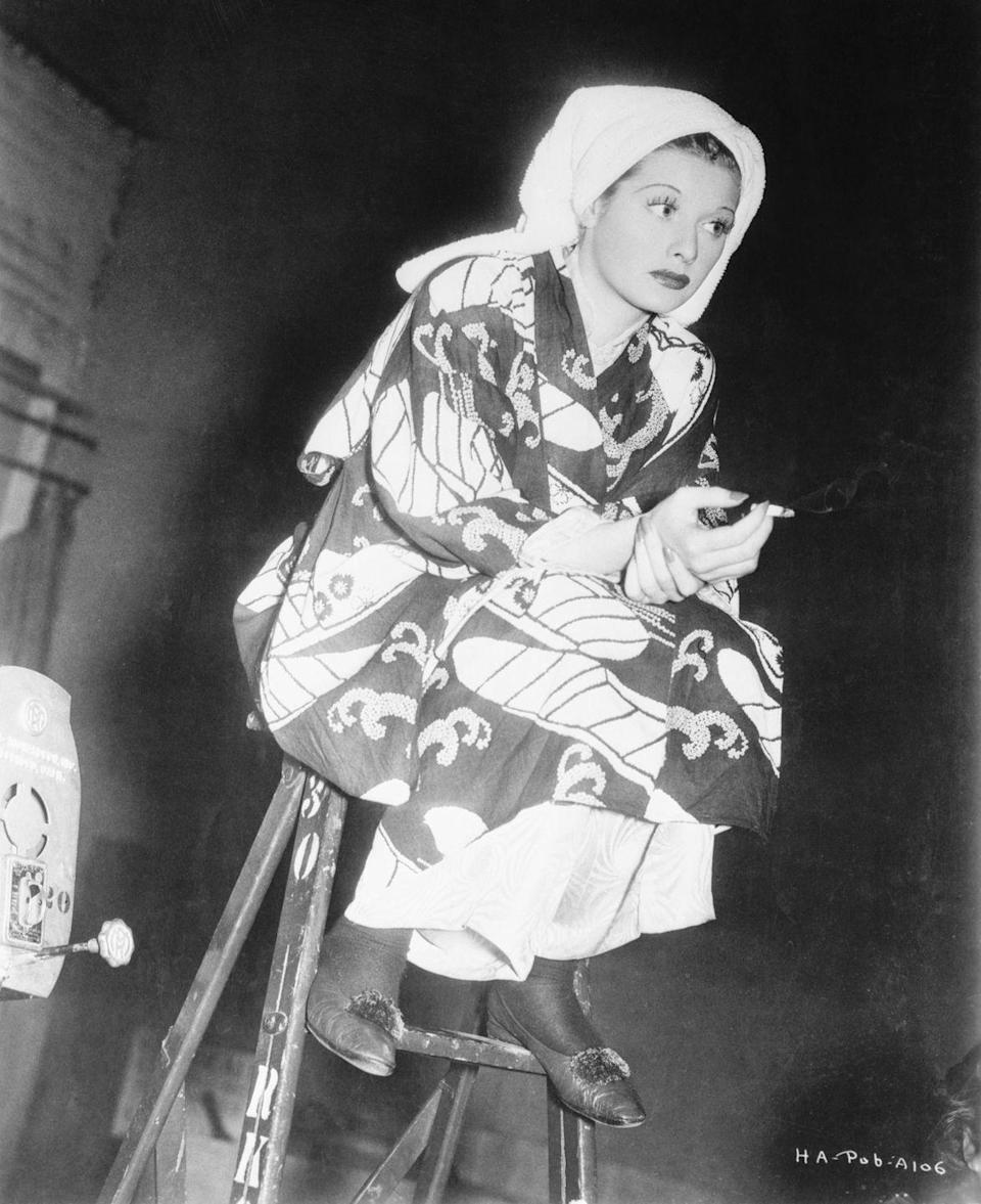 <p>Lucille wears a robe and her hair wrapped in a towel on the set of the romantic comedy <em>Having Wonderful Time</em>, which she costarred in with Ginger Rogers, Douglas Fairbanks Jr. and Red Skelton.</p>
