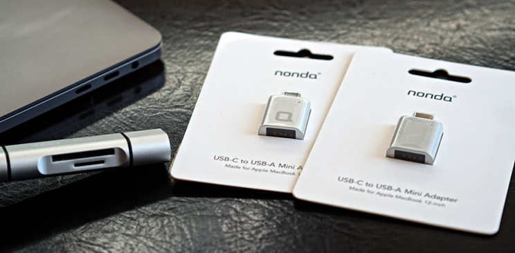 Meet your new adapters: an SD card reader (left), and a pair of USB adapters.