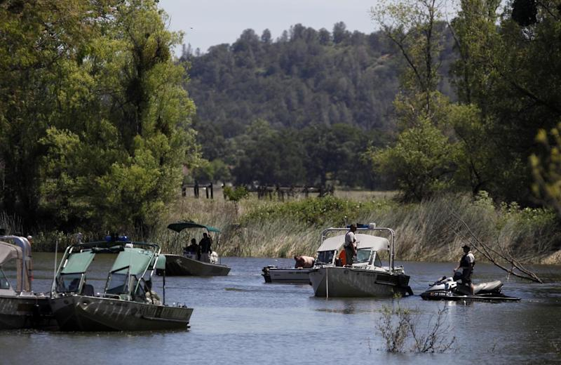 Law enforcement agencies use boats and divers to search Cache Creek for missing 9-year-old autistic girl Mikaela Renee Lynch behind her home in Clearlake, Calif. on Monday, May 13, 2013. Her body was found in the creek Wednesday, May 15, 2013. (AP Photo/The Press Democrat, Beth Schlanker)