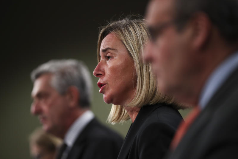 "European Union Foreign Policy chief Federica Mogherini, center, talks to journalists during a joint news conference with UN High Commissioner for Refugees Filipo Grandi, left, and UN Migration Agency Director General Antonio Vitorino at the EU headquarters in Brussels, Tuesday, Oct. 29, 2019. The European Union says a ""solidarity conference"" has raised around 120 million euros ($133 million) for Venezuelans fleeing their crisis-wracked country and to help countries who are hosting them. (AP Photo/Francisco Seco)"