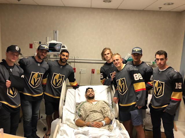 Golden Knights players (L-R) Reid Duke, Deryk Engelland, Pierre-Edouard Bellemare, Jon Merrill, Nate Schmidt, Luca Sbisa and Reilly Smith visit UNLV's Nick Robone (C) at the hospital in October. (Photo courtesy Nick Robone)