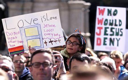 Demonstrators gather at Monument Circle to protest a controversial religious freedom bill recently signed by Governor Mike Pence during a rally in Indianapolis March 28, 2015. REUTERS/Nate Chute