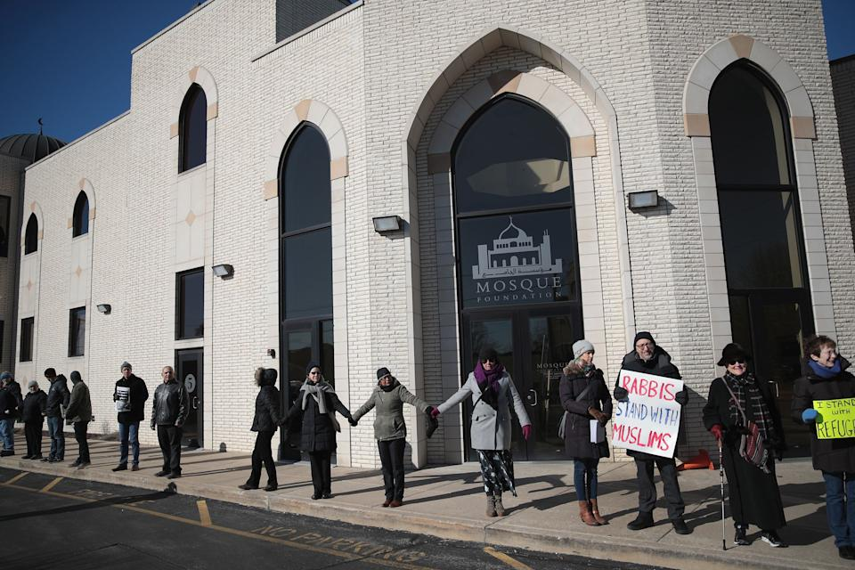 Interfaith religious leaders join together in a show of support for the Muslim community outside the Mosque Foundation on February 3, 2017 in Bridgeview, Illinois.