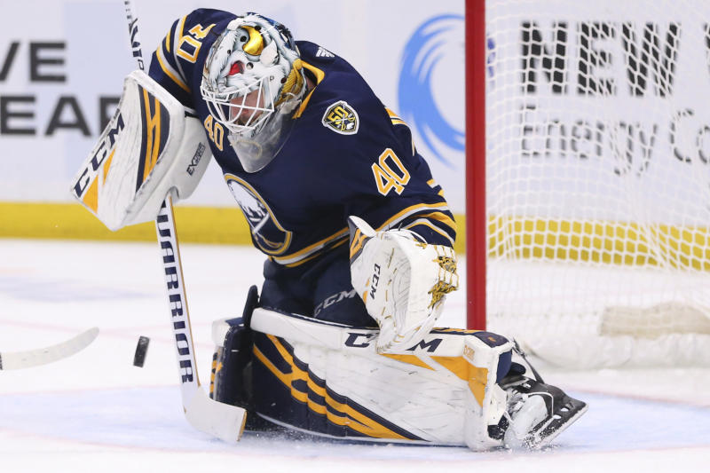 Buffalo Sabres goalie Carter Hutton (40) makes a save during the second period of an NHL hockey game against the Vancouver Canucks, Saturday, Jan. 11, 2020, in Buffalo, N.Y. (AP Photo/Jeffrey T. Barnes)