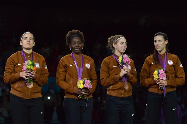 Team USA celebrates with the bronze medal on the podium of the women's epee team as part of the fencing event of London 2012 Olympic games, on August 4, 2012 at the ExCel centre in London. AFP PHOTO / ALBERTO PIZZOLIALBERTO PIZZOLI/AFP/GettyImages