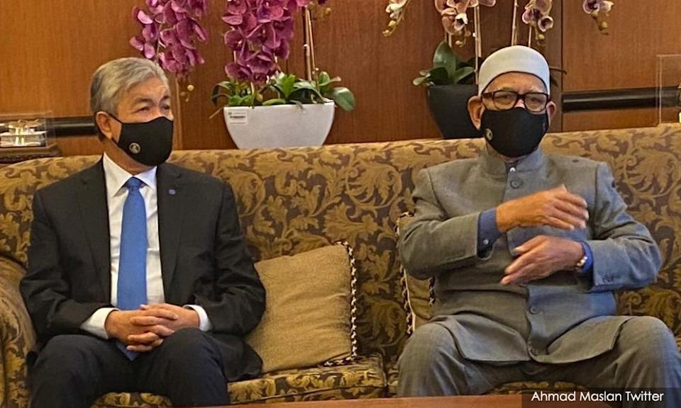 Ahmad Zahid Hamidi (left) and Abdul Hadi Awang