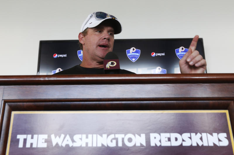 Washington Redskins head football coach, Jay Gruden, gestures during a news conference at the Redskins NFL training camp in Charlottesville, Va., Wednesday, July 24, 2019. (AP Photo/Steve Helber)