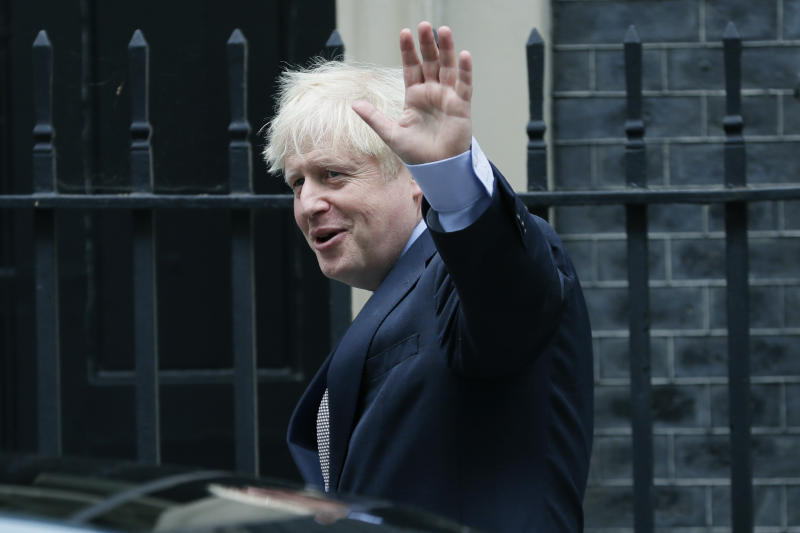 Britain's Prime Minister Boris Johnson leaves Downing Street to attend the weekly session of Prime Ministers Questions in Parliament in London, Wednesday, Sept. 9, 2020. (AP Photo/Kirsty Wigglesworth)