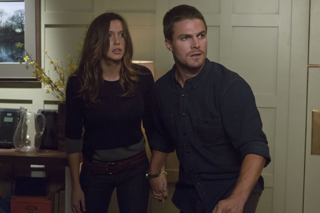 """""""Honor Thy Father"""" -- Katie Cassidy as Laurel and Stephen Amell as Oliver Queen"""