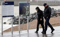 People walk along the promenade in Dover, Kent. Parts of the UK are preparing to be lashed by heavy rain and high winds as Storm Alex heralds the arrival of a stretch of bad weather over the weekend.