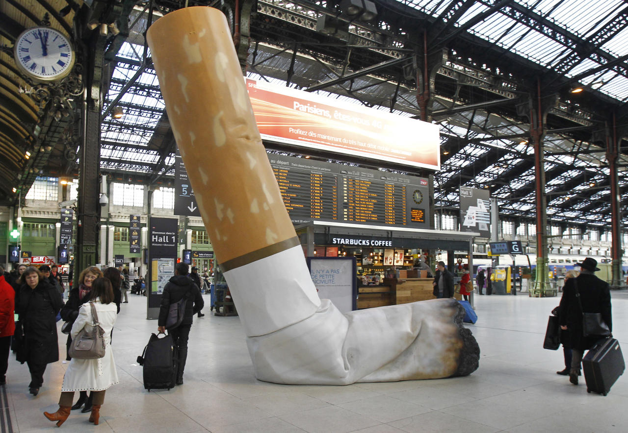 A symbolic cigarette butt is set up inside Gare de Lyon railway station, in Paris, Tuesday Dec. 4, 2012, as part of a publicity campaign against rudeness, by Paris's public transport authority.  The possibility of apparent rudeness is being counteracted by an advertising campaign as tourism companies and the Paris transport authority address concerns of tourists during the financial crisis. (AP Photo/Remy de la Mauviniere)