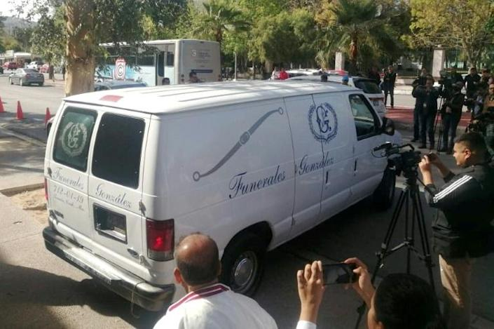 A funeral van leaves the Mexican school where a student shot and killed a teacher (AFP Photo/Brenda Alcala)
