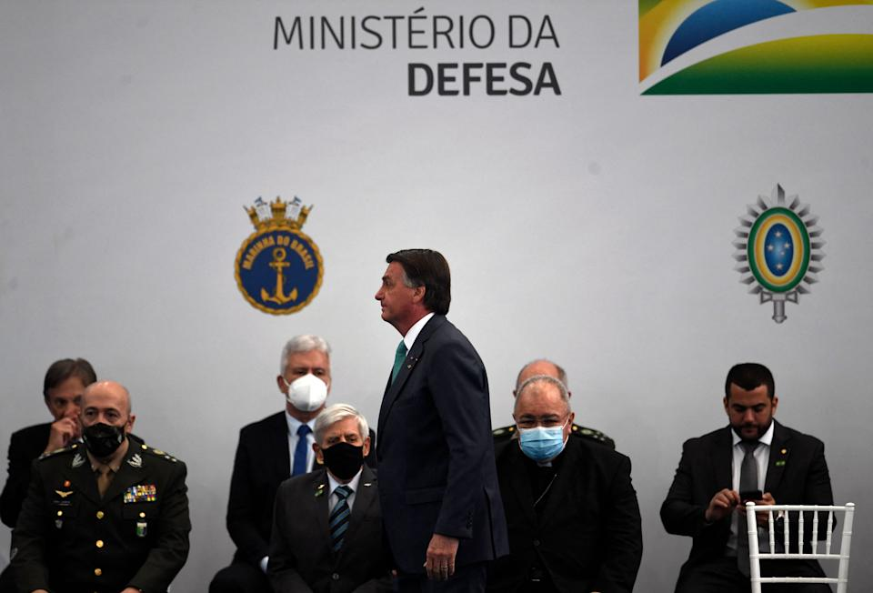 Brazil's President Jair Bolsonaro (C) walks during a ceremony to honor Brazilian military athletes who went to the Tokyo 2020 Olympic Games at the Navy Sports Headquarters in Rio de Janeiro, Brazil on September 01, 2021. (Photo by MAURO PIMENTEL / AFP) (Photo by MAURO PIMENTEL/AFP via Getty Images)