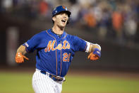 New York Mets' Pete Alonso reacts after hitting a home run during the seventh inning in the second game of a baseball doubleheader against the Miami Marlins, Monday, Aug. 5, 2019, in New York. (AP Photo/Mary Altaffer)