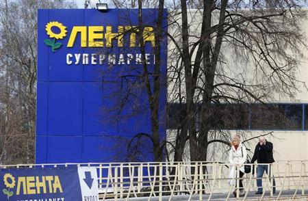 People walk out of a Lenta supermarket in Moscow