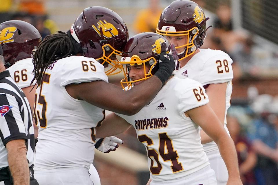 Central Michigan place kicker Marshall Meeder, right, celebrates with offensive lineman Deiyantei Powell-Woods after kicking a 51-yard field goal against Missouri during the second half on Sept. 4, 2021, in Columbia, Missouri.