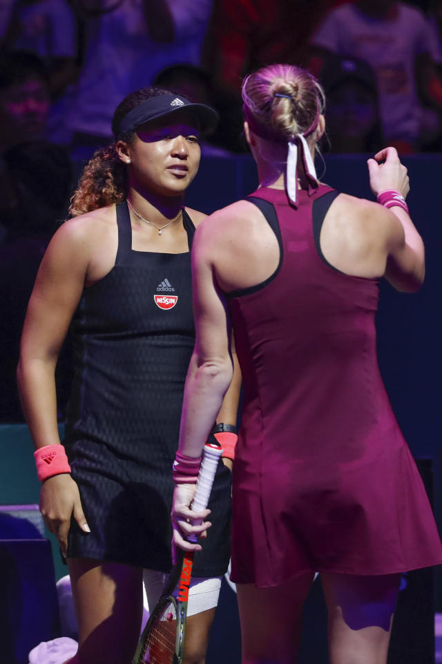 Naomi Osaka of Japan, hugs by Kiki Bertens of the Netherlands after she retiring fromm the match during their women's singles match at the WTA tennis finals in Singapore, Friday, Oct. 26, 2018. (AP Photo/Vincent Thian)