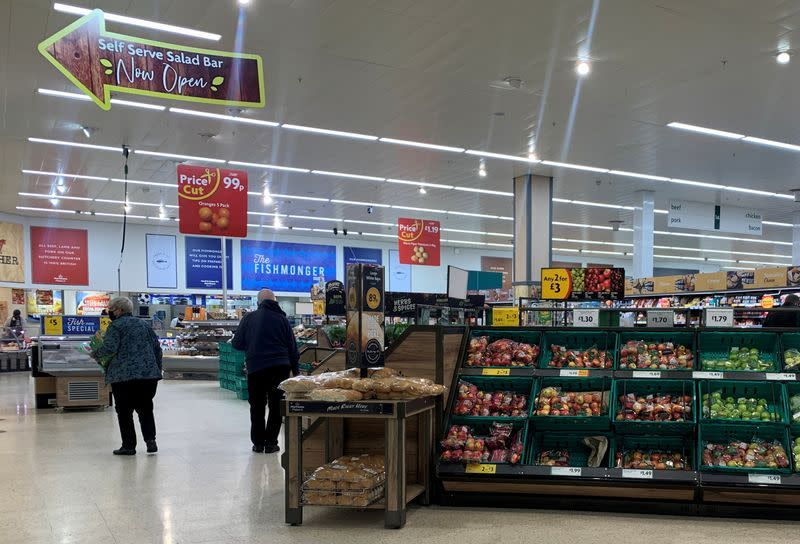 FILE PHOTO: Customers wearing face masks are seen inside a Morrisons supermarket in New Brighton