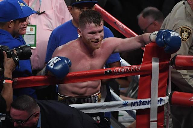 Canelo Alvarez celebrates his unanimous-decision victory over Julio Cesar Chavez Jr. in their catchweight bout at T-Mobile Arena on May 6, 2017 in Las Vegas, Nevada (AFP Photo/Ethan Miller)
