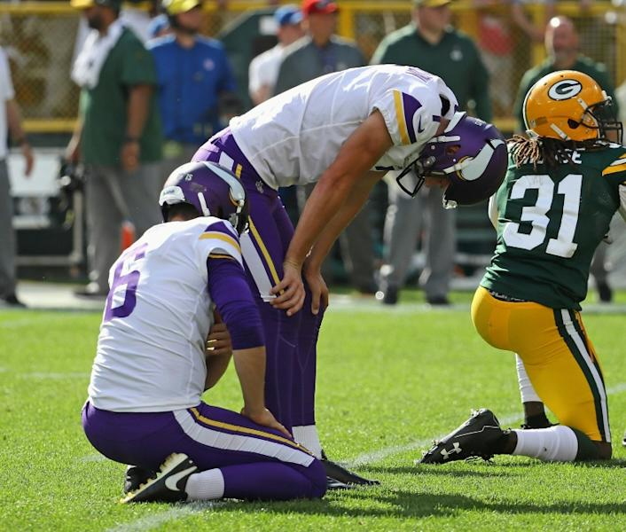 Minnesota Vikings kicker Daniel Carlson reacts to missing a potential game-winning field goal against the Green Bay Packers. He was released by the club a day later