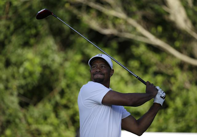 Tiger Woods tees off on the third hole during the third round of the Honda Classic golf tournament, Saturday, March 1, 2014, in Palm Beach Gardens, Fla. (AP Photo/Lynne Sladky)