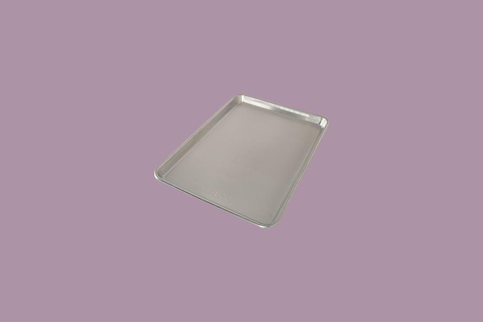 """<p>Though it's not a grill tool specifically, as big fans of the <a href=""""https://www.marthastewart.com/7847984/sheet-pans-baking-sheets-cookie-pans-pick"""" rel=""""nofollow noopener"""" target=""""_blank"""" data-ylk=""""slk:sheet pan"""" class=""""link rapid-noclick-resp"""">sheet pan</a>, we see their value when it comes to preparing a grilled meal. They're incredibly useful for ferrying prepped ingredients to the grill or taking cooked food back into the kitchen for plating, and these pans from Nordic Ware are similar to the ones our test kitchen uses. We like that they are durable, have rim to prevent food from sliding off, and don't warp.</p> <p><em><strong>Shop Now: </strong>Nordic Ware Naturals Baker's Half-Sheet Pan,</em> <em>$10.99, <a href=""""http://goto.target.com/c/249354/81938/2092?subId1=MSLOurGuidetoGrillingToolsIncludestheEssentialsandSomeExtrasvspence2BBQGal7972055202008I&u=https%3A%2F%2Fwww.target.com%2Fp%2Fnordic-ware-naturals-baker-s-half-sheet%2F-%2FA-14901174"""" rel=""""nofollow noopener"""" target=""""_blank"""" data-ylk=""""slk:target.com"""" class=""""link rapid-noclick-resp"""">target.com</a>.</em></p>"""