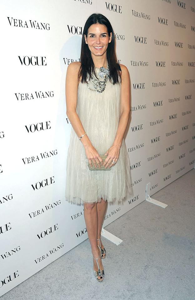 "Angie Harmon was all smiles in her fairy-like frock. Too bad the actress opted not to do anything with her limp locks! John Shearer/<a href=""http://www.wireimage.com"" target=""new"">WireImage.com</a> - March 2, 2010"