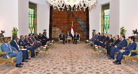 Egyptian President Abdel Fattah al-Sisi meets with Ethiopian Prime Minister Abiy Ahmed and delegations of the two governments at the Ittihadiya presidential palace in Cairo, Egypt, June 10, 2018. in this handout picture courtesy of the Egyptian Presidency. The Egyptian Presidency/Handout via REUTERS