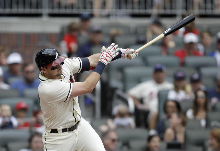 Atlanta Braves' Austin Riley swings for an RBI single off New York Mets pitcher Noah Syndergaard in the first inning of a baseball game Sunday, Oct. 3, 2021, in Atlanta. (AP Photo/Ben Margot)