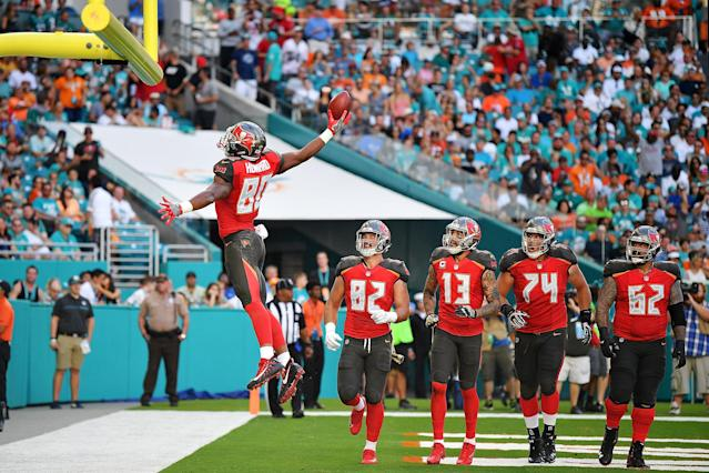 <p>O.J. Howard #80 of the Tampa Bay Buccaneers celebrates after scoring a touchdown during the second quarter against the Miami Dolphins at Hard Rock Stadium on November 19, 2017 in Miami Gardens, Florida. (Photo by Mark Brown/Getty Images) </p>