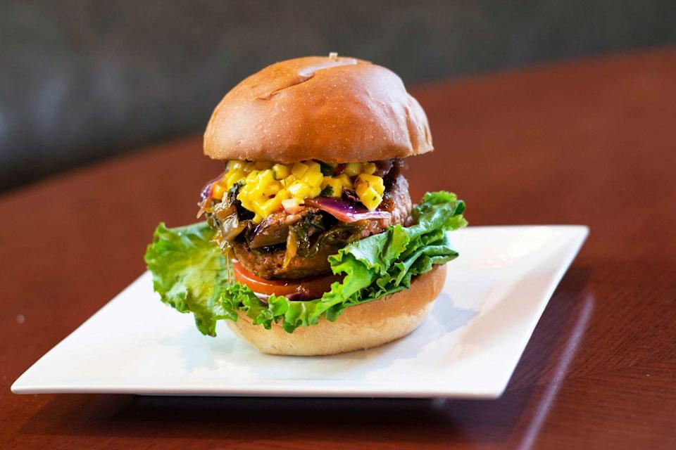 <p>D-Luxe Burger in Disney Springs is known for its eclectic array of menu options well beyond your basic patty and bun. Their Plant-based Pacific Island Burger will leave your mouth watering with its mango salsa, vegan patty, and mushroom ragout; all topped with dill pickles. </p>