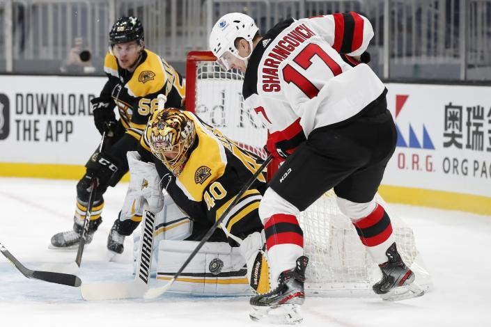 Boston Bruins' Tuukka Rask (40) blocks a shot by New Jersey Devils' Yegor Sharangovich (17) during the first period of an NHL hockey game, Sunday, March 7, 2021, in Boston. (AP Photo/Michael Dwyer)