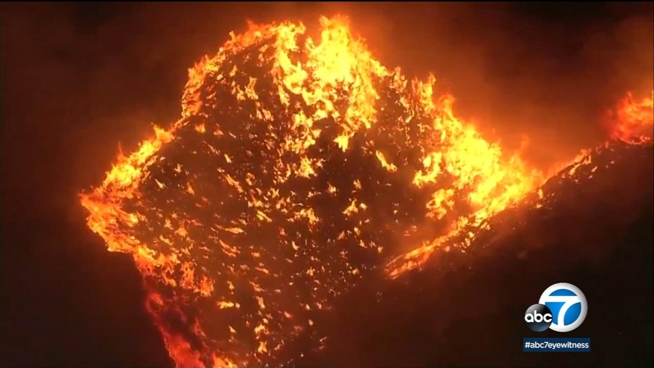 Crews are battling a fast growing brush fire that broke out Saturday afternoon in the Riverside County community of Juniper Flats and has burned 200 acres.