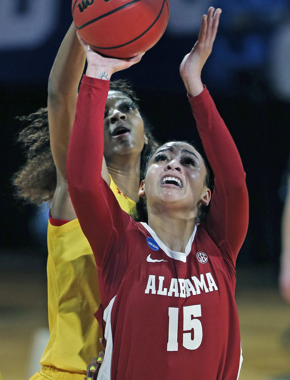 CORRECTS THE DATE TO MARCH 24, NOT MARCH 23 AS ORIGINALLY SENT - Maryland forward Angel Reese, rear, blocks a shot attempt by Alabama's Myra Gordon (15) during the first half of a college basketball game in the second round of the women's NCAA tournament at the Greehey Arena in San Antonio on Wednesday, March 24, 2021. (AP Photo/Ronald Cortes)