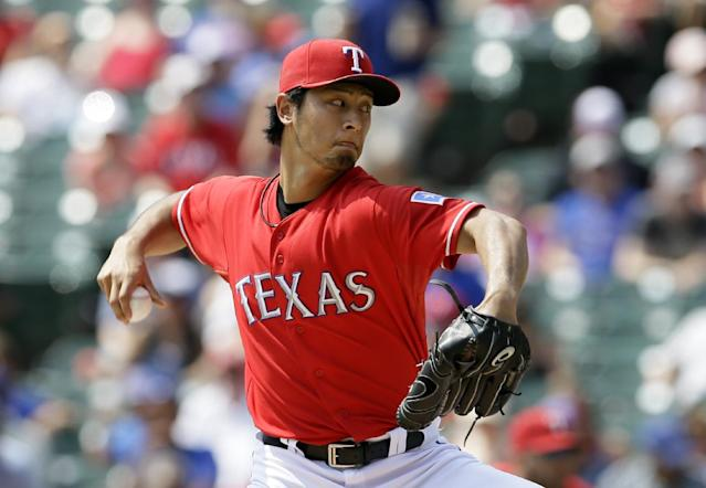 Texas Rangers' Yu Darvish, of Japan, works against the Oakland Athletics in the first inning of a baseball game, Saturday, Sept. 14, 2013, in Arlington, Texas. (AP Photo/Tony Gutierrez)