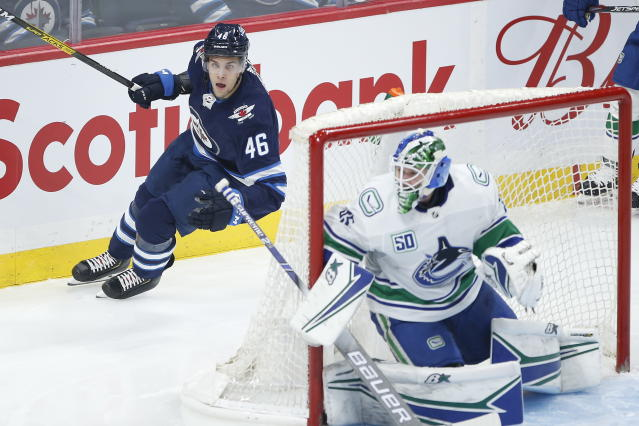Winnipeg Jets' Joona Luoto (46) skates during the first period of an NHL hockey game against the Vancouver Canucks, Friday, Nov. 8, 2019 in Winnipeg, Manitoba. (John Woods/Canadian Press via AP)