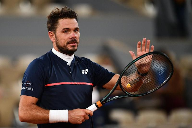 Switzerland's Stan Wawrinka celebrates after winning against Britain's Andy Murray during their men's singles first round tennis match on Day 1 of The Roland Garros 2020 French Open. Photograph: Anne-Christine Poujoulat/AFP.