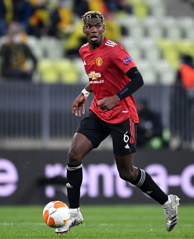 Paul Pogba takes the ball forward with his right foot
