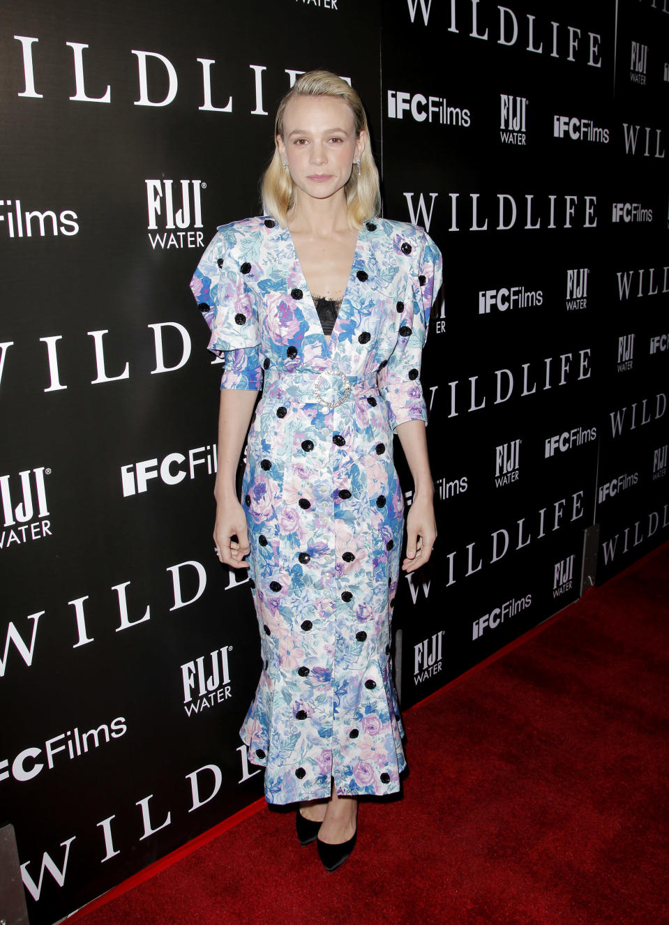 <p>Carey opted for wear a floral dress with statement sleeves for the premiere of her upcoming flick. <em>[Photo: Getty]</em> </p>
