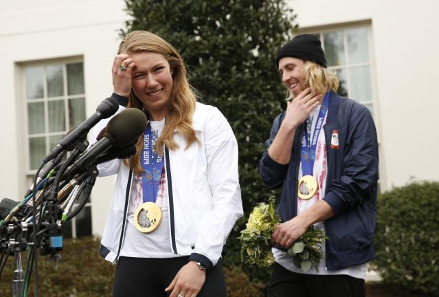 REFILE - QUALITY REPEAT Olympic gold medalists slalom athlete Mikaela Shiffrin (L) and slopestyle snowboarder Sage Kotsenberg talk to reporters at the White House in Washington April 3, 2014. U.S. President Barack Obama and first lady Michelle Obama will honor members of the U.S. teams and delegations from the Sochi Olympics and Paralympics at the White House today. REUTERS/Kevin Lamarque (UNITED STATES - Tags: POLITICS SPORT OLYMPICS)